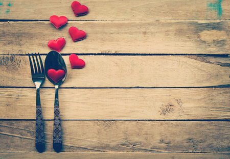eating dinner: Valentines day dinner with table setting in rustic wood