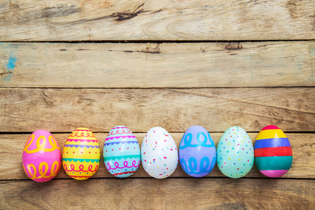 background design: Easter eggs on wooden background with space Stock Photo