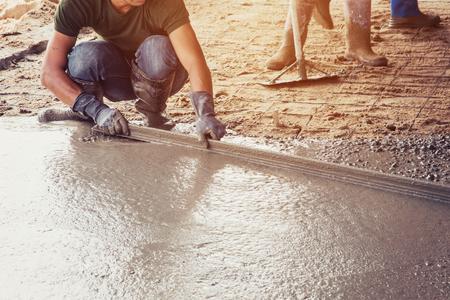 plasterer: Plasterer screed concrete for floor in building Stock Photo