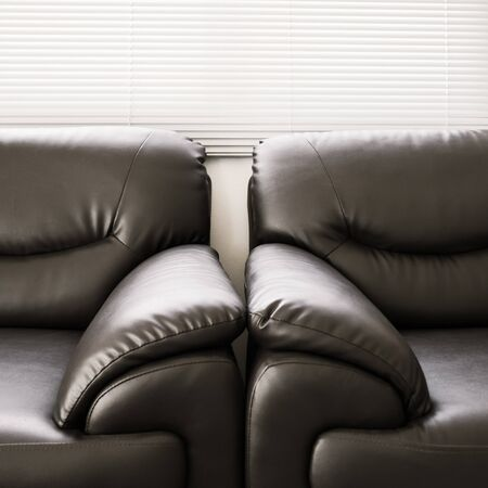 living room sofa: sofa leather black furniture in living room Stock Photo
