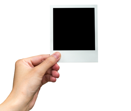 photo paper: hand holding photo frame on isolated white with clipping path.