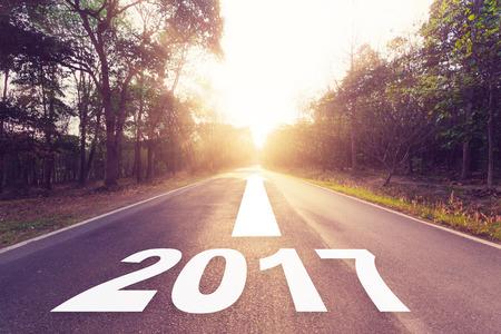 Empty asphalt road and New year 2017 concept. Standard-Bild