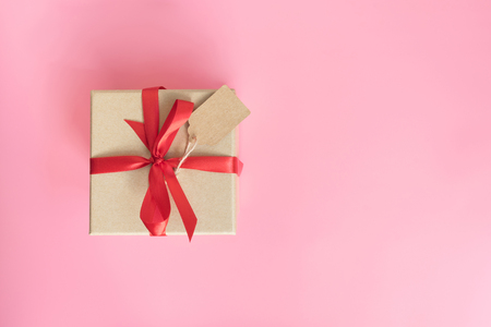 top view brown gift box for new year on pink pastel color background with space.
