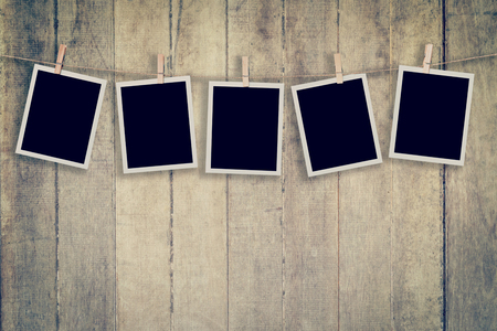 Five instant photo on Wood Background and Texture vertical, Vintage toned. 版權商用圖片