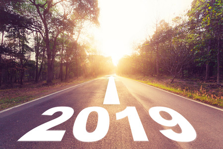 Empty asphalt road and New year 2019 concept. Driving on an empty road to Goals 2019. Banco de Imagens