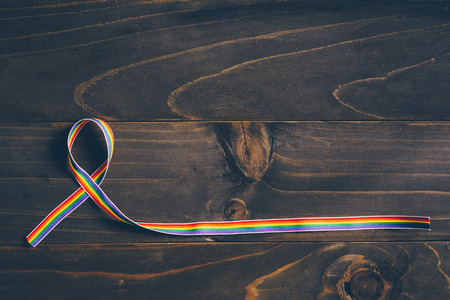 Rainbow ribbon awareness for LGBT concept on wooden background. Banque d'images