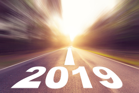 Empty blur asphalt road and New year 2019 concept. Driving on an empty road to Goals 2019.