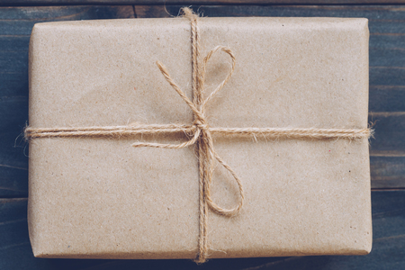 String or twine tied in a bow on paper gift box texture 写真素材