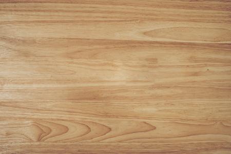 hout bruin graan textuur, donkere muur achtergrond, bovenaanzicht van houten tafel met kopieerruimte.