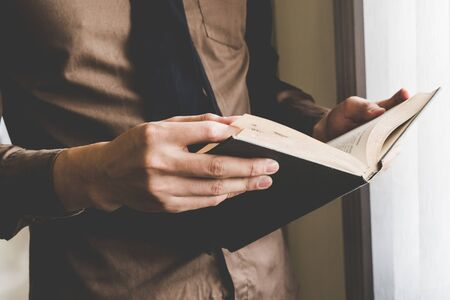 Businessman holding book at window. Creative Business Startup Idea.