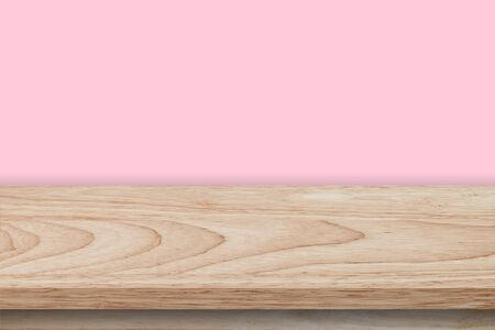 Empty wooden table and pink wall background texture, display montage with copy space. Фото со стока