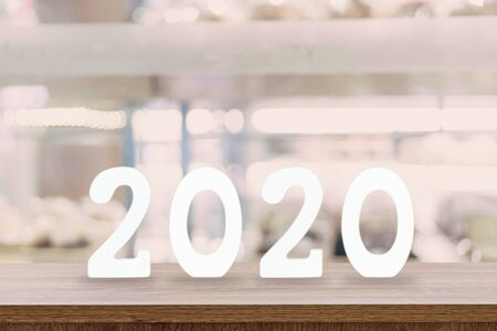 2020 New Year concept - wooden word  2020  on table and blur light background Фото со стока
