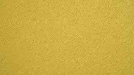 Texture of grunge panorama yellow leather. Yellow background. Фото со стока
