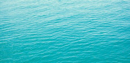 Panorama of clear blue sea with waves background