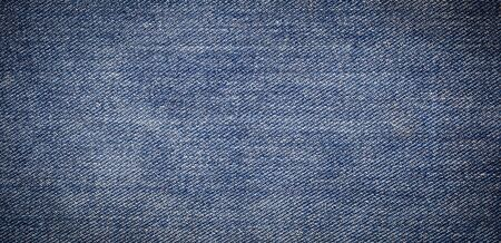 panorama of old blue jeans background and texture Фото со стока - 128414072