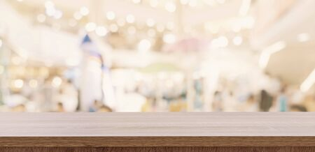 Empty wood table and blurred light table in shopping mall with bokeh background. product display template. Фото со стока