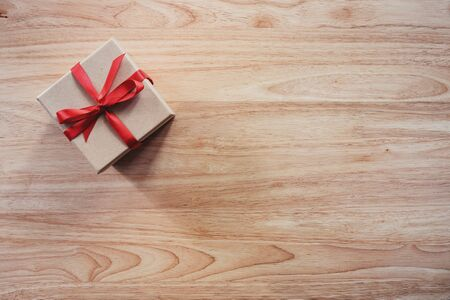 Brown gift box on wooden table background with copy space Фото со стока