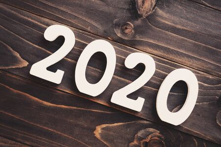2020 New year concept : 2020 wood number on table background.