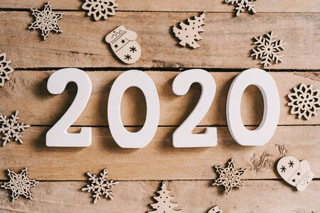 2020 New year concept on wood table and christmas decoration background.