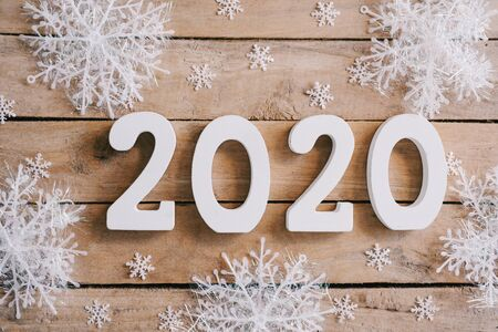 2020 New year concept on wood table decoration background.