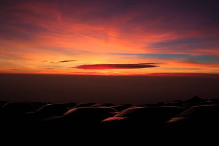 clound: sunset above the car