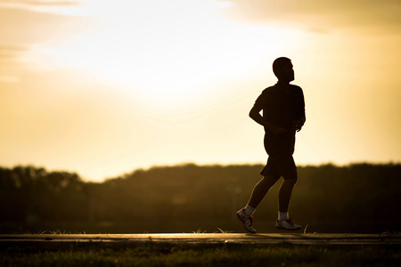 evenings: A man jogging in the evenings. Stock Photo