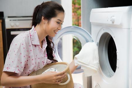 Women washing clothes The washing machine