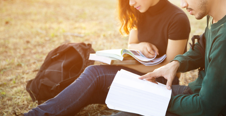 consulted: Students were consulted course for the exams they sat outdoors the grass Stock Photo