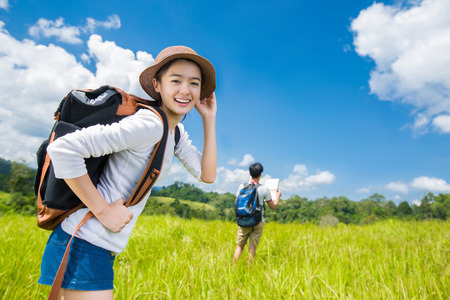 Asian women are travel naturally mountain tourism in the summer. boyfriend View map Stock Photo