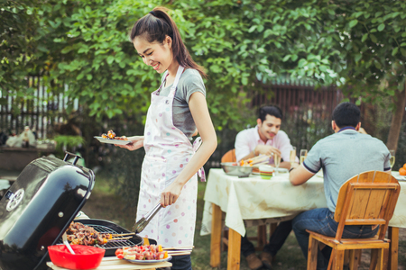 People asians barbecue party in the garden   Stock Photo