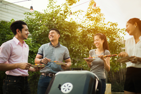 Dinner party, barbecue and roast pork at night Stock Photo - 75499679