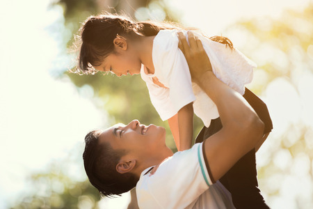 Father carrying daughter Up looking at each other Happily, the early morning hours