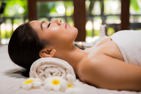 woman having massage and spa salon Beauty treatment concept, She is very happy,top view