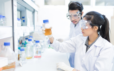 Asian scientist  in the laboratory working at lab with test tubes Stock Photo