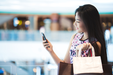 Asian women The purchasing power of the mall happy .Her phone shop Stock Photo