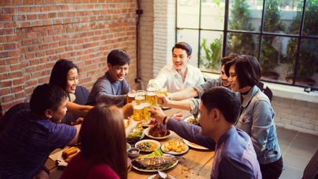 People in asian are celebrating the festival they clink glasses beer and dinner happy