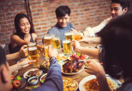 People in asian are celebrating the festival they clink glasses beer and dinner happy.top view Stock Photo