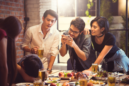 Group of friends taking pictures people who are intoxicated from drinking the Asians. Stock Photo