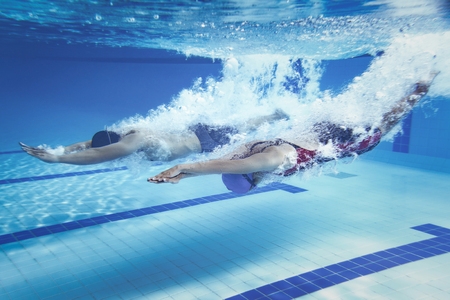 swimmer  Jump from platform jumping A swimming pool.Underwater photo Zdjęcie Seryjne