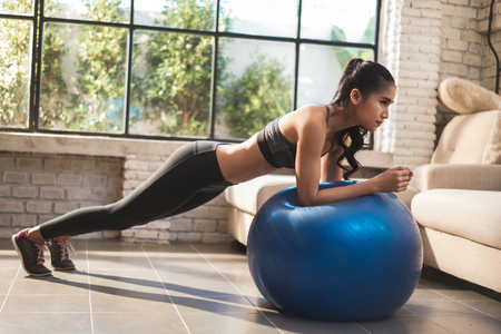 Asian women exercise at home she acted plank on the ball. Stock Photo