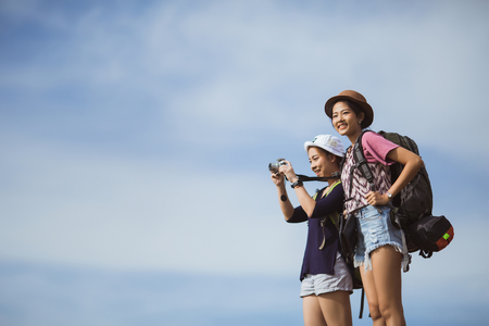 Asian tourists are photographing travel women