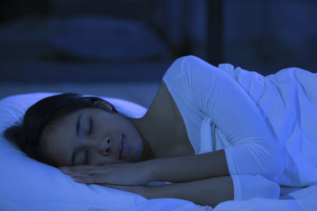 Asian woman is sleeping at night.