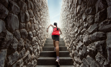 Women are exercising by running up the stairs.