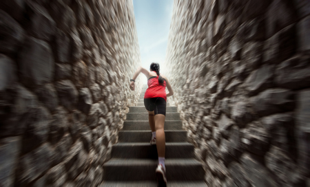Women are exercising by running up the stairs.motion blur Stock Photo