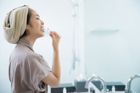 Asian women are brushing teeth in the morning to the bathroom Stock Photo - 81778015