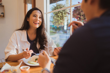 Asian women Are eating at the restaurant in the morning. Stock Photo