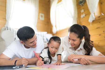 black family: Father and mother Teaching children to do their homework at home