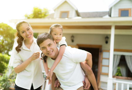 Asian family portrait with happy people smiling at home