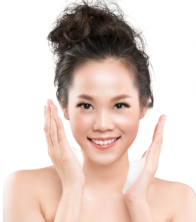 Asian woman use a facial foam to wash cosmetics off the face Stock fotó