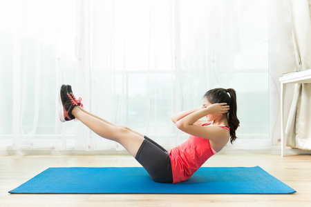 Asian women are exercising at home.Abdominal exercises Sit ups.